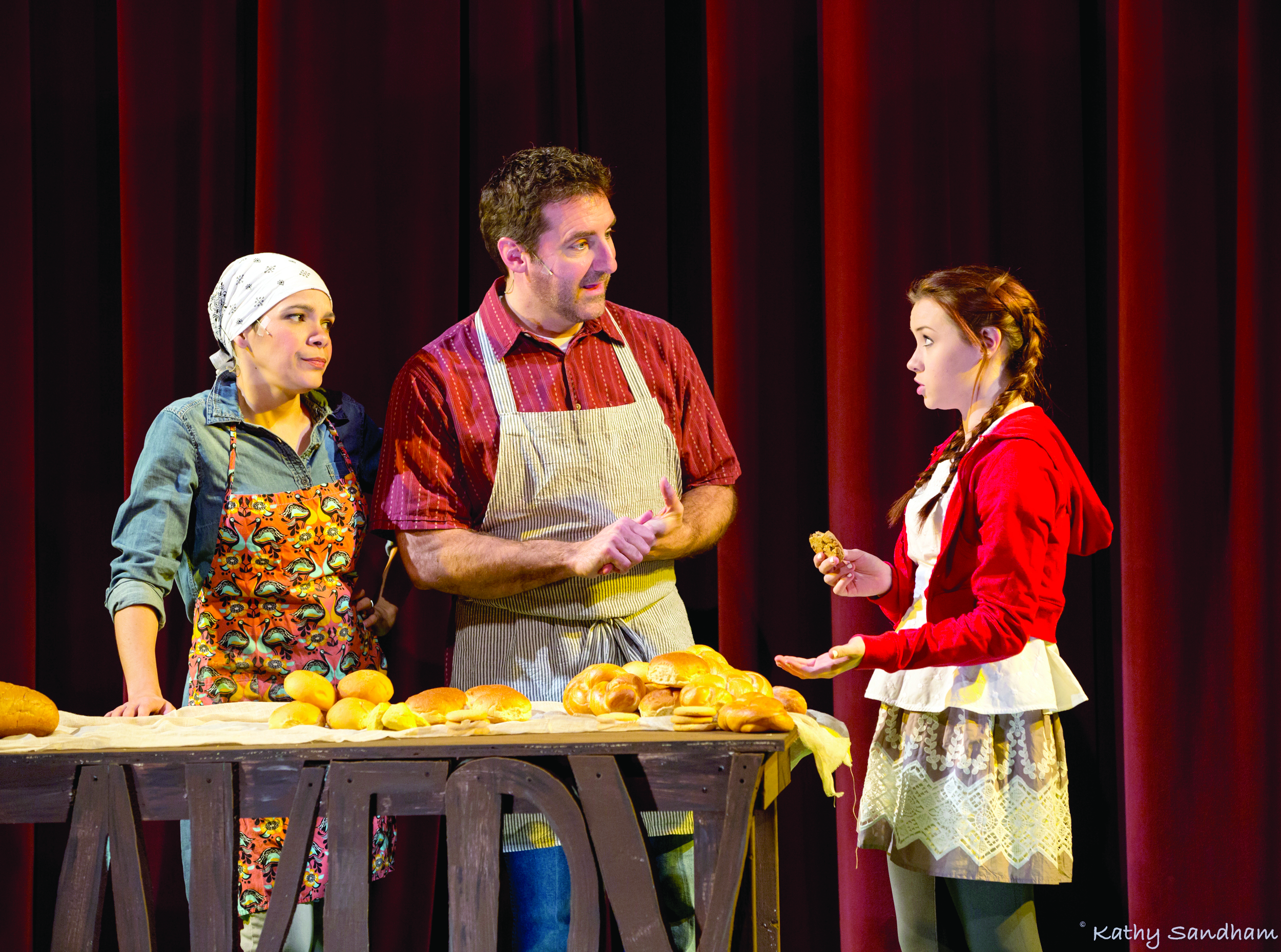 Trinidad Snider, from left, as the baker's wife, Brian Altman as the baker, and Jade McGee as Little Red Riding Hood. PHOTO   Kathy Sandham