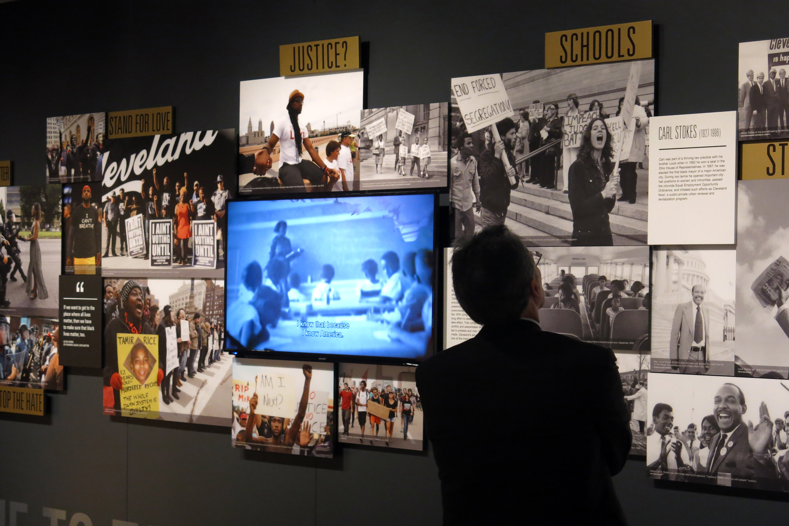 "Kenneth B. Liffman, a member of the Maltz Museum board of trustees, inspects the Cleveland section of ""This Light of Ours."" 